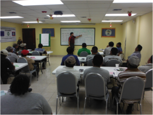 Henry Quesada teaches cost allocation to sugar cane farmers in Belize as part of the financial management training.